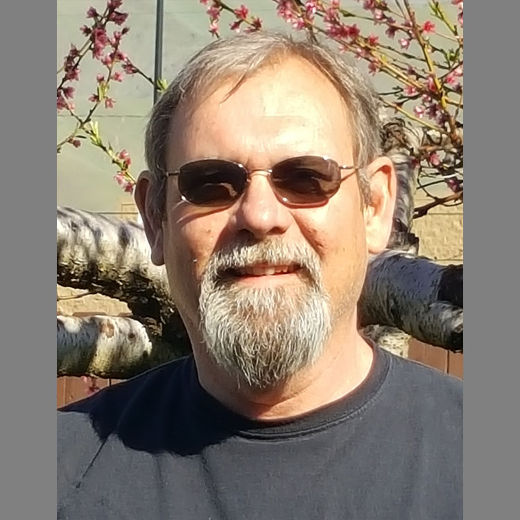 A portrait of Russ Evans